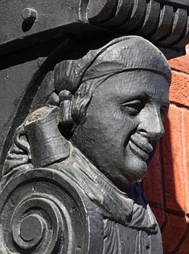carving of drunk on nag's head